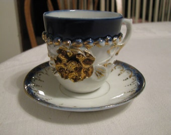 Vintage Mini Cup and Saucer White Blue Gold Raised Flower and Gold Accents