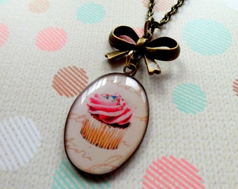 Cute as Cupcake Necklace. Cupcake Resin Pendant with Bow Charm. Bronze Tone.
