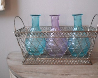 wedding table decoration .. Jewel Tone aqua and purple bottles in Silver mesh Basket ... vases basket