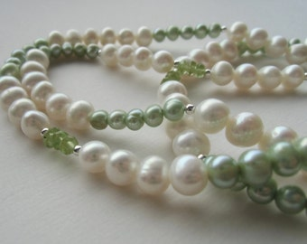 Pastel green/white/peridot pearl continuous necklace.