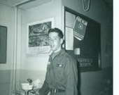 1960s Army Soldier Standing by Barracks Water Fountain Colorado Training Vietnam War Era Black and White Vintage Photo Photograph