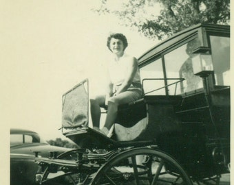 Woman in Shorts Sitting on a Stage Coach Historical Visit 1940s 50s Vintage Photo Snapshot Black White Photograph