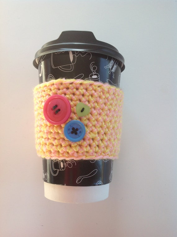 Yellow and pink Crocheted coffee cozy with 3 buttons