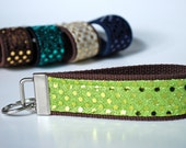 Key fob sparkle sequin fabric wristlet in lime green color