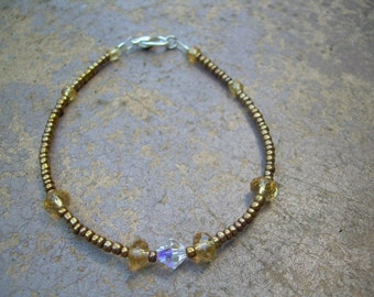 beautiful Ooak Beaded Bracelet with Faceted Cirtine colored crystals AB Bicone and Seed beads Only one like this