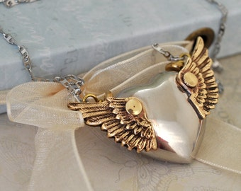 THE WINGED HEART steampunk winged puffy heart necklace with watch gears and surgical steel chain