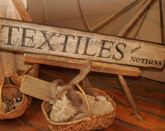 Early looking Antique Primitive 'Textiles and Notions' Wooden Sign