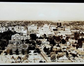 "RPPC 1930's ""Business Section of Portland, Oregon"" - Park Blocks, Steel Bridge, 1st Congregational Church, Roosevelt Hotel, Mt. St. Helens"