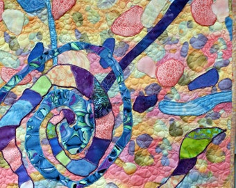 Quilt art a wall hanging  art quilt in deep blue, peach and purple abstract spirial