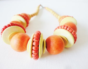 big chunky eccentric necklace with orange wood beads