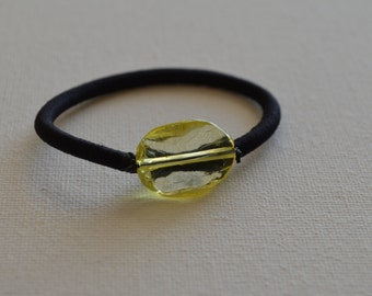 Yellow wavy acrylic oval bead, ponytail holder