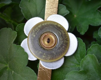 Gold leather snap bracelet with silver leather flower and large green & gold vintage buttons
