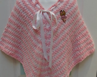HAND KNITTED PONCHO: childs, pink and white striped, made of cuddle spun yarn, for the 5 to 6 year old,with a  Ballerina applique