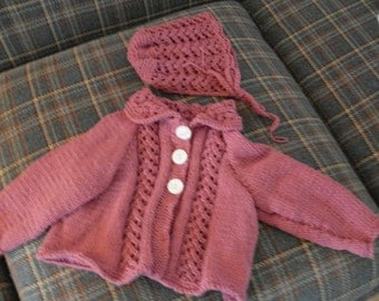 Hand knit baby girl's rose colored lacy sweater set