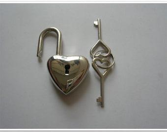 Nickel little heart shape purse lock 3.6cm x 2.3cmFrom bagpurseframes