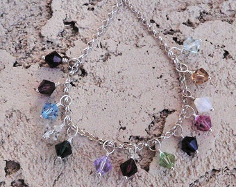 Add a Swarovski Crystal and sterling charm to your order