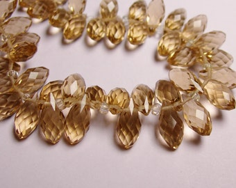 Faceted teardrop crystal briolette beads - 24 pcs - 12mm by 6mm - top sideways drill - topaz color