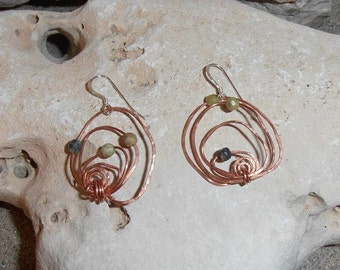 Serpent Path- This pair of Circular Free Form Hammered Copper earrings features Serpentine beads and Silver ear wires.