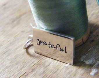 hand stamped grateful tag sterling silver