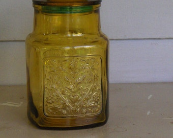 Authentic Vintage 1970's Wheaton Amber glass vintage canister with hearts, dove, fish.