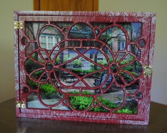 mini park benches in red window frame