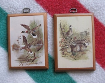 A Pair of James R. Smith Bird Wood Plaques