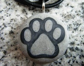 Dog Print hand carved on a polymer clay sand granite color background. Pendant comes with a FREE 3mm necklace