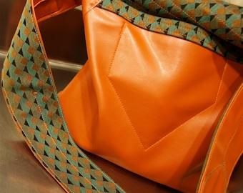 Orange patterned messenger bag