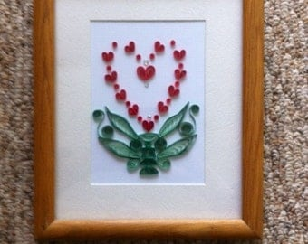 Quilled heart in green vase, framed made of twelve hearts, framed