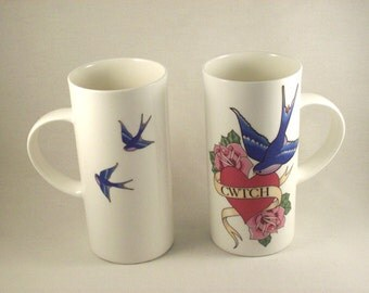 Tattoo inspired cwtch mug featuring swallows, roses and hearts.