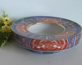 Vintage Imari style Japanese ceramic bowl with gold trim.Asian fire bird pattern