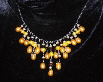 Stunning 17 in. Thai sterling silver, mango and burnt orange freshwater pearls, 9x7 garnet and swarovski crystal bib necklace.