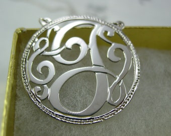 "monogram initial. 1.25"" size. with a  chain. Sterling silver"