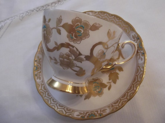 Tuscan cup and saucer circa 1950's-  964