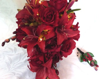 Cascading red rose bridal bouquet red rose lily and orchid wedding bouquet and boutonniere bouquet with LED lights