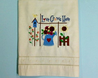 Embroidered tea towel, birdhouse and flower design