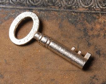 Antique miniature metal skeleton key. old