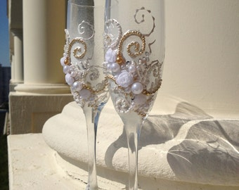 Wedding toasting glasses, hand decorated with an original design in white and gold
