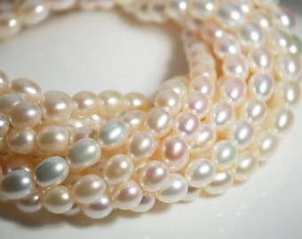 """Full  15"""" strand: 9-10mm rice shape freshwater pearls, white, rice pearls, one strand, grade AA to AAA, natural white color, 15 inch stand"""