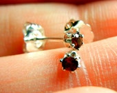 Very tiny red garnets in sterling silver earring stud posts (the birthstone for January)