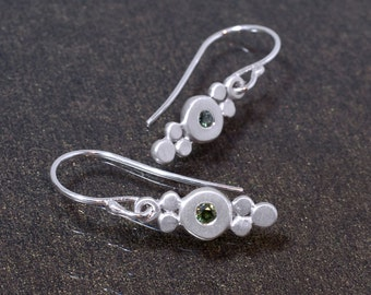 Silver earrings with green sapphires