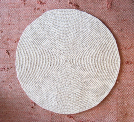small off-white round wool rug mat