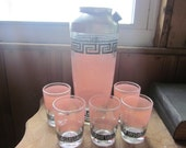 pink and black cocktail shaker with glasses, barware, drinks,