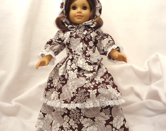 White and dark brown floral dress for 18 inch dolls, double skirted, with white lace trim.