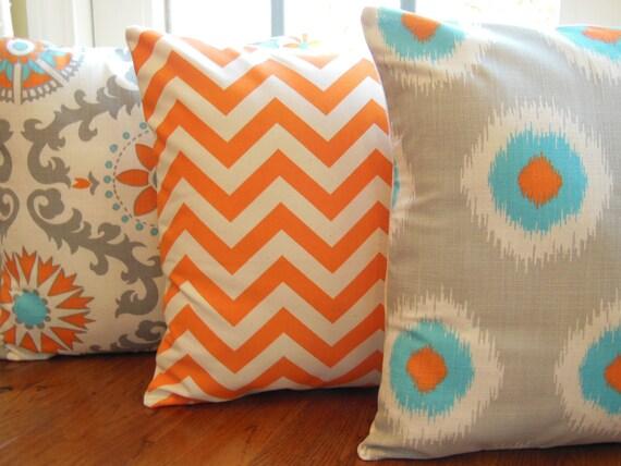 gray sofa orange pillows - photo #16