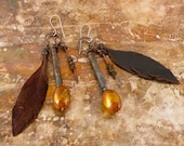 Rustic earrings.  Recycled metal, leather and ceramic beads.