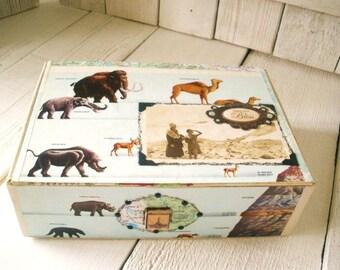 Vintage cigar box explorers art embellished prehistoric animal