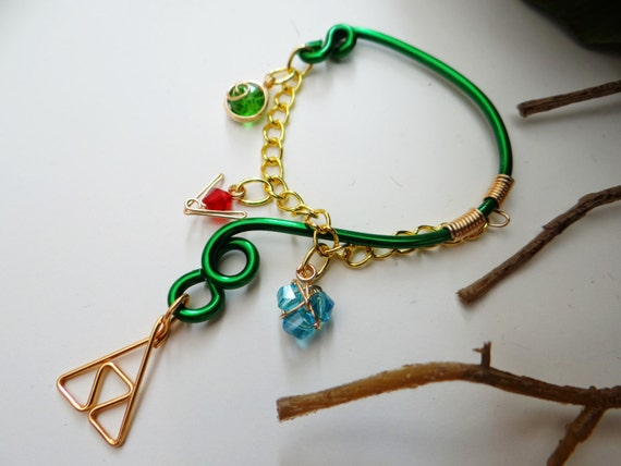 The Legend of Zelda's® Wise Ear Bend with Hanging Spiritual Stones and Triforce