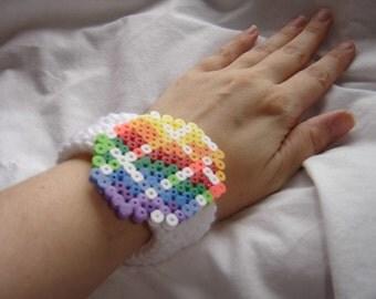 crochet bracelet pixel art 8bit rainbow cut gem shape bangle cuff white acrylic yarn colorful gem perler bead embellishment
