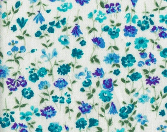 Light weight cotton twill floral fabric in turquoise and periwinkle blues